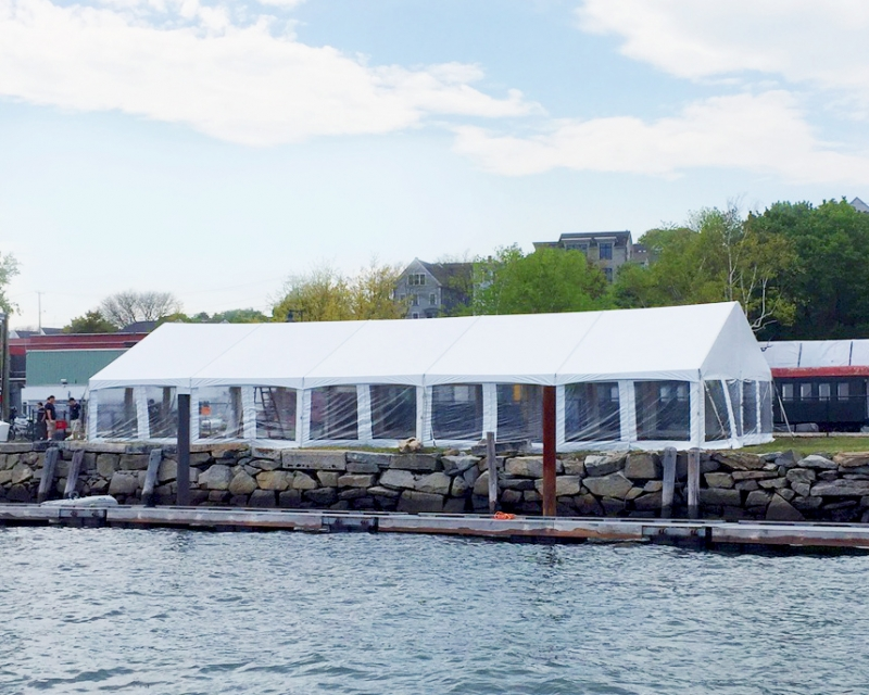 H2K tent set up by the water