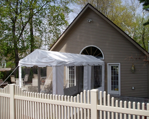 marquee tent setup on side of house