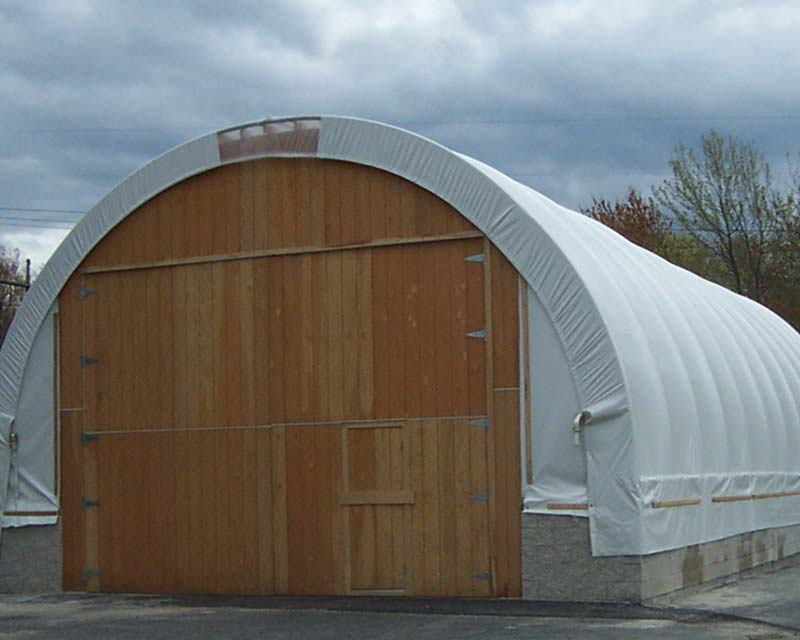 Fabric Farm structure with wooden front wall