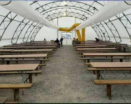 Fabric structure with picnic tables inside