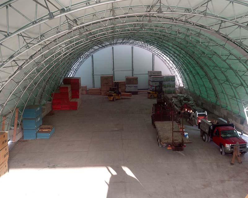 fabric structure with farm equipment