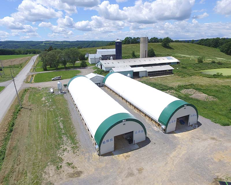 Aerial view of two Fabric Farm structure on farm