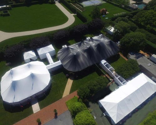 Aerial View of a black tent with 2 white tents attached