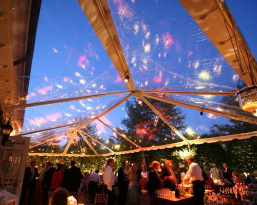 Clear panels in party tent under night sky
