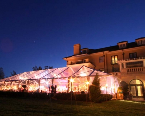 clear wedding tent with bright lights inside