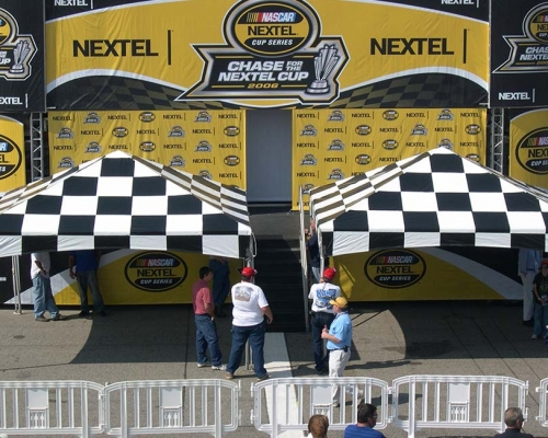 2 checkered flag theme tents at nascar race