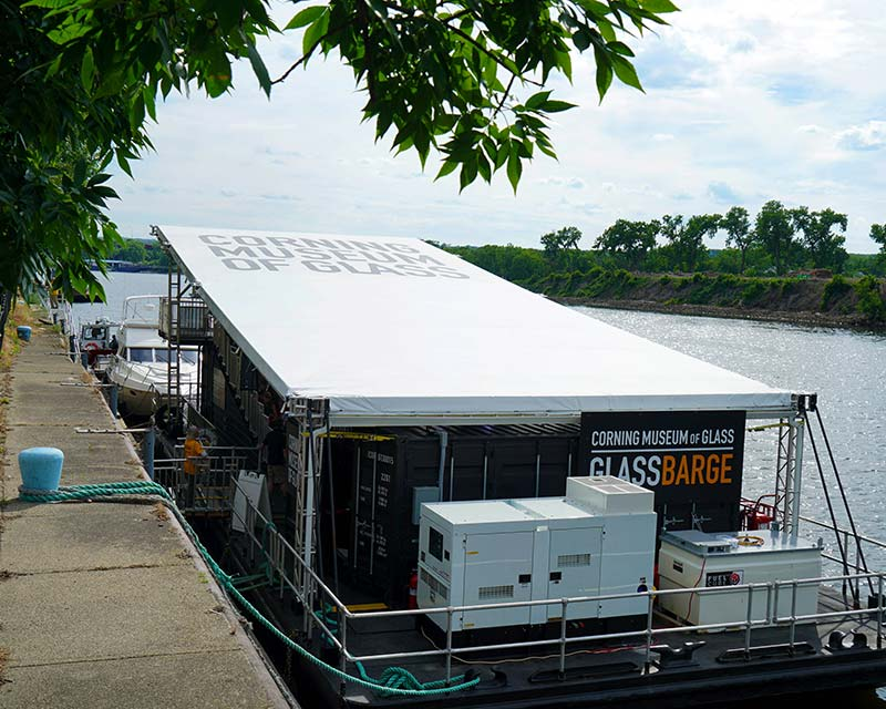 Large tent on top of docked barge