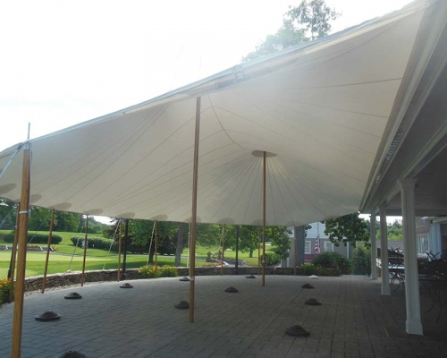 Tent siting on patio overlooking gold course