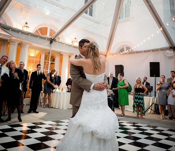 couple dancing underneath a clear frame tent at wedding