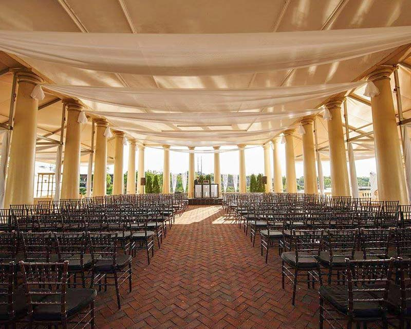 inside of large hall setup with chairs for guests