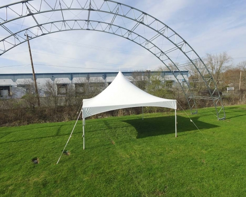 White Frame tent setup on grass