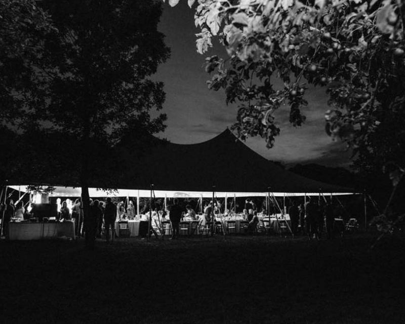 Wedding tent with tables, chairs and guests