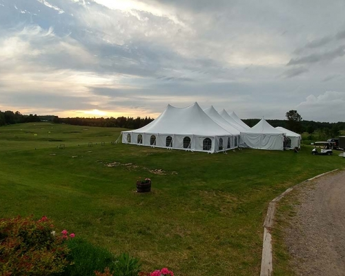 white wedding tent in field