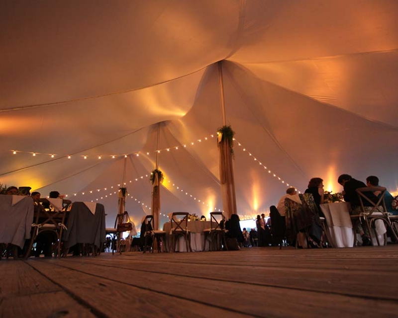 Inside of a wedding tent with string lights