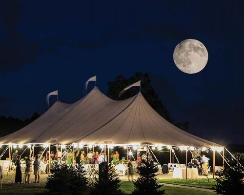 Large wedding tent setup under the moon