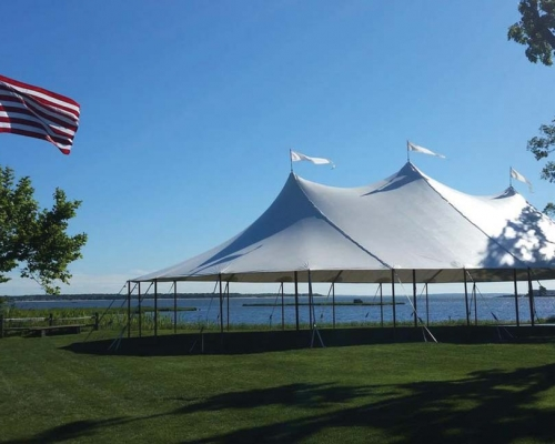 Wedding tent setup next to the water
