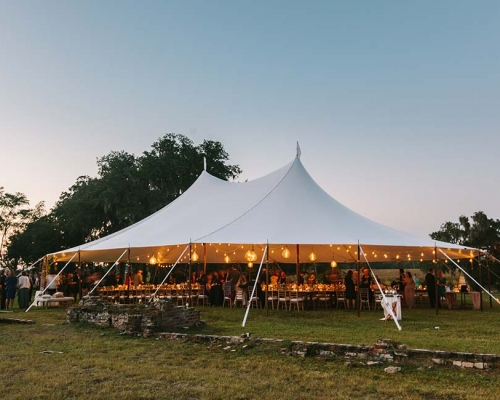 White wedding tent with string lights