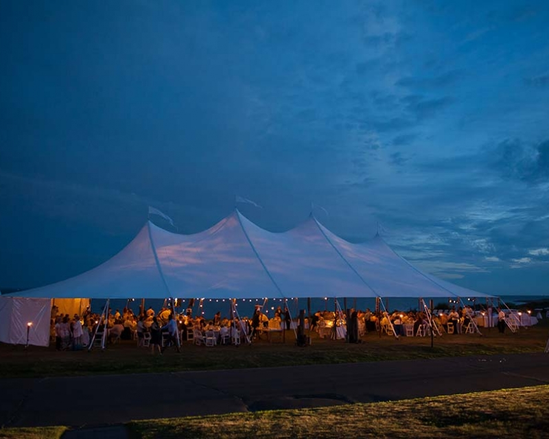 large wedding tent with guests inside