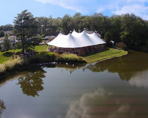 wedding tent setup next to pond