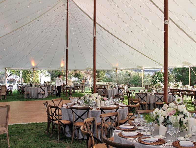 Interior shot of a sailcloth frame tent being used for a wedding
