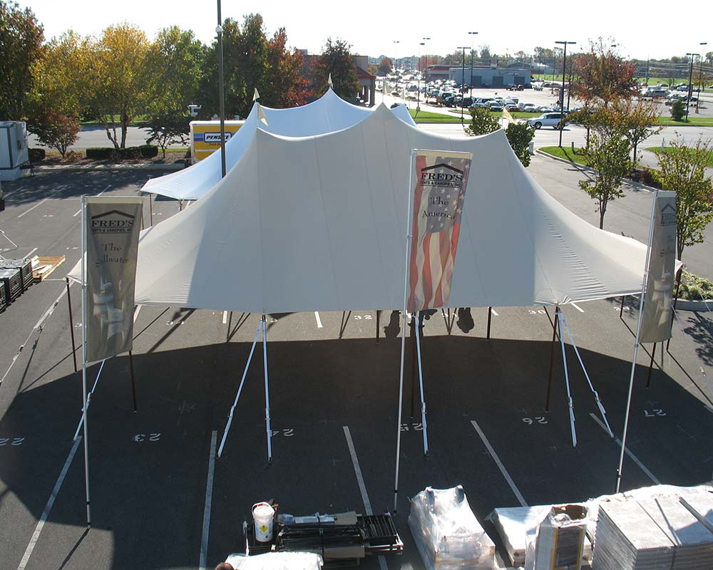 Sailcloth tent setup in parking lot