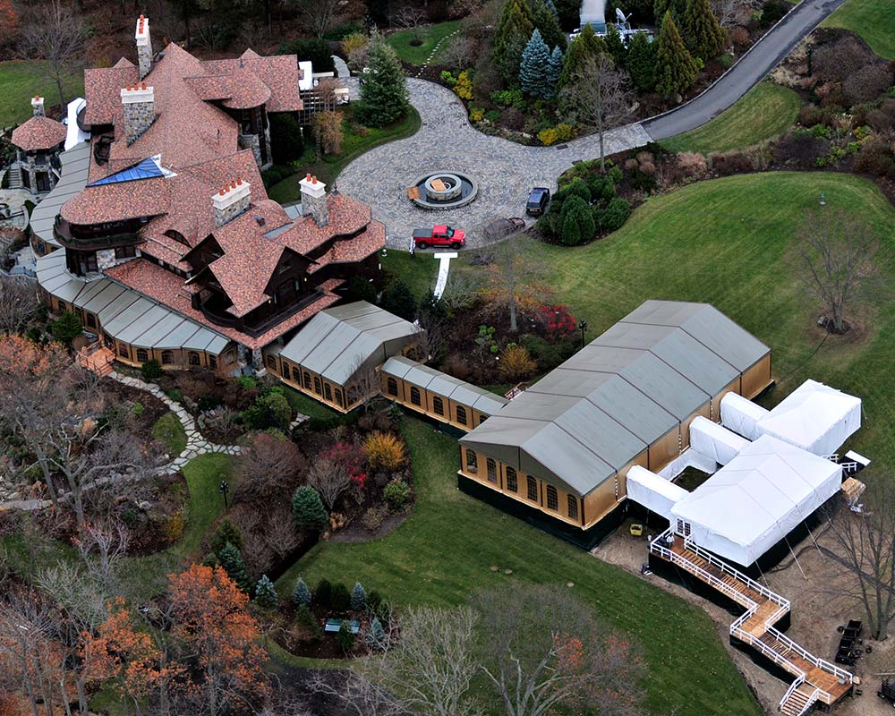 aerial view of house with attached custom tents