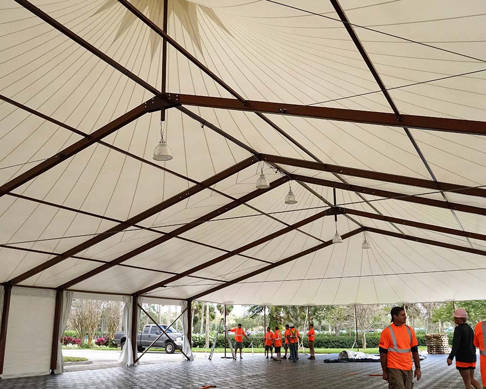 Sailcloth Frame tent with lights being setup