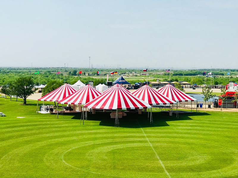group of custom tents in a field