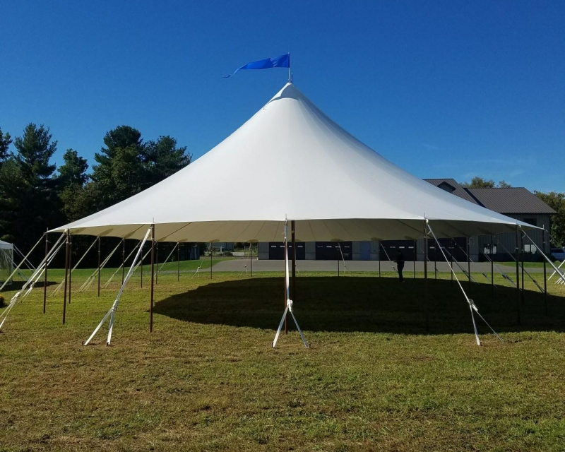 Center pole tent setup on lawn