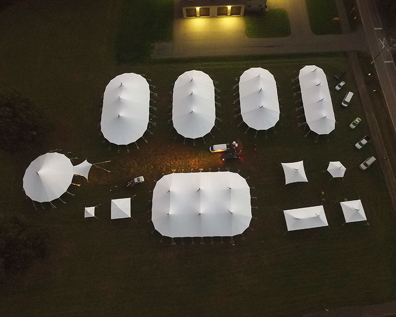 Aerial view of Sailcloth tents set up in a field