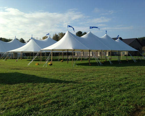 3 Large white tents setup on lawn