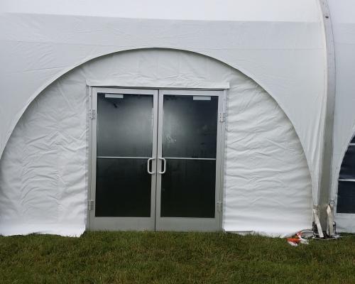 Aluminum door installed with tent
