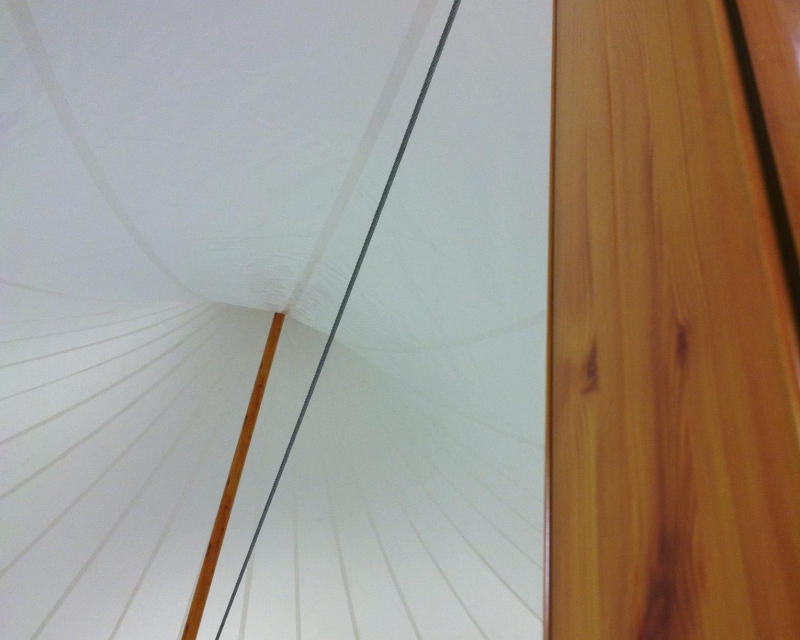 Wood finished aluminum center poles inside tent