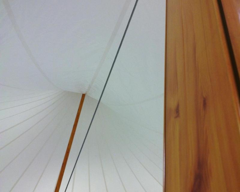 Wood finished aluminum center poles inside tent