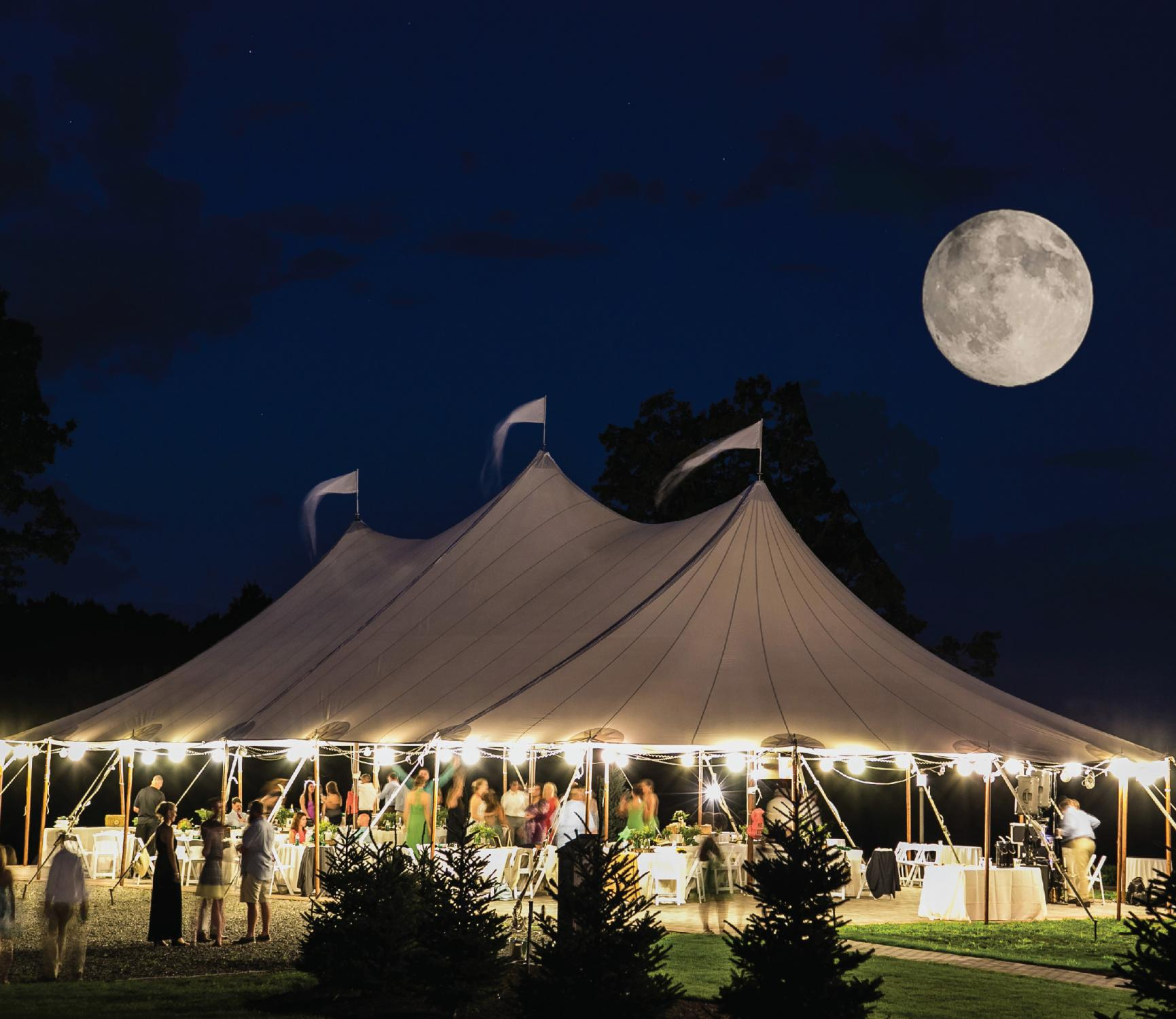 Stillwater tent at night with moon