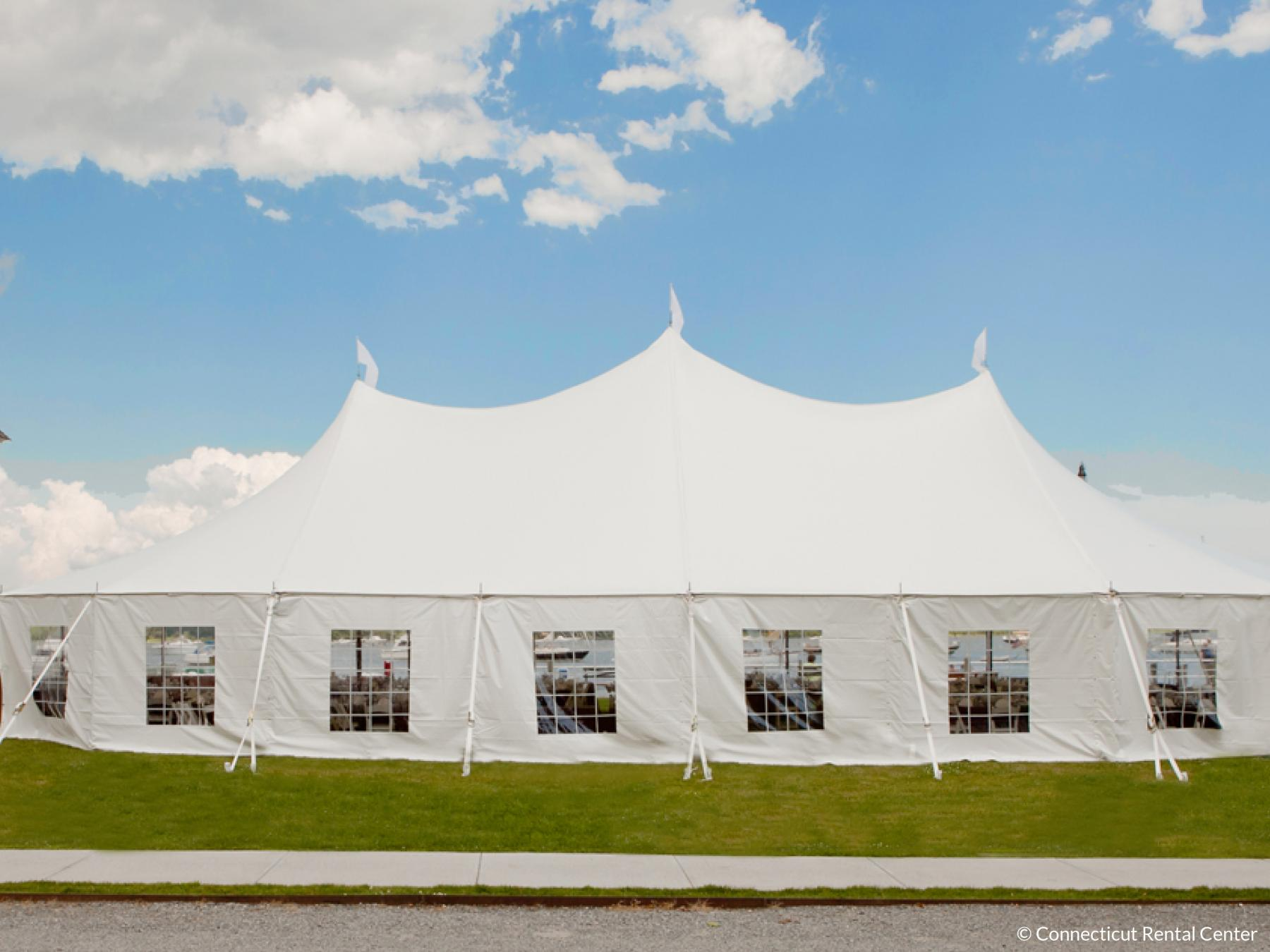Stillwater tent by the water on nice sunny day