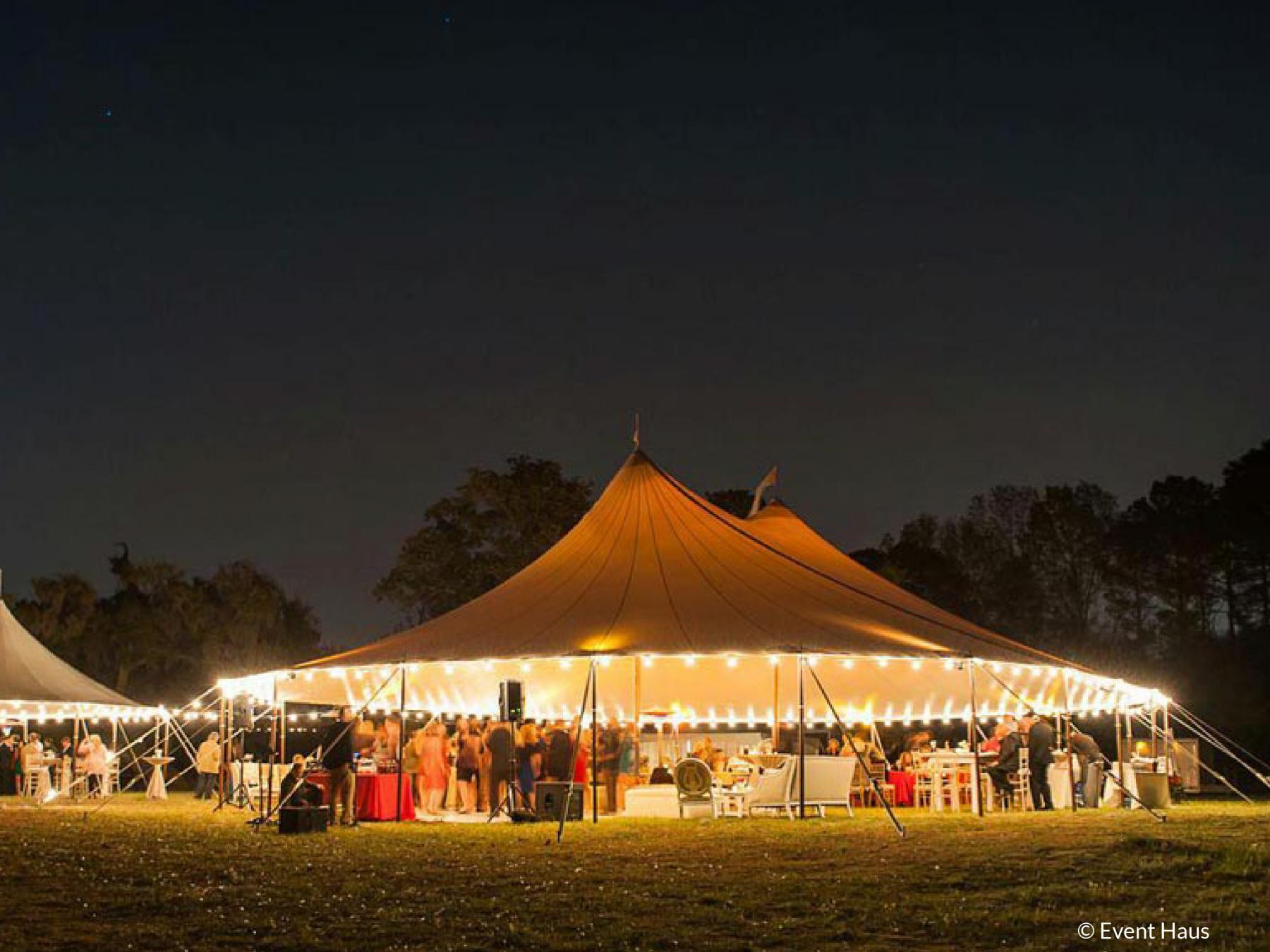 Stillwater tent at night setup with lights