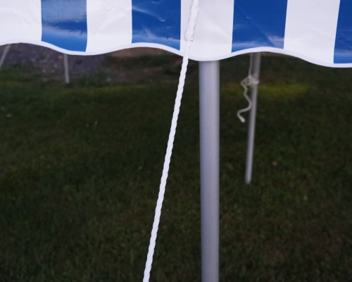 tent pole with blue striped tent