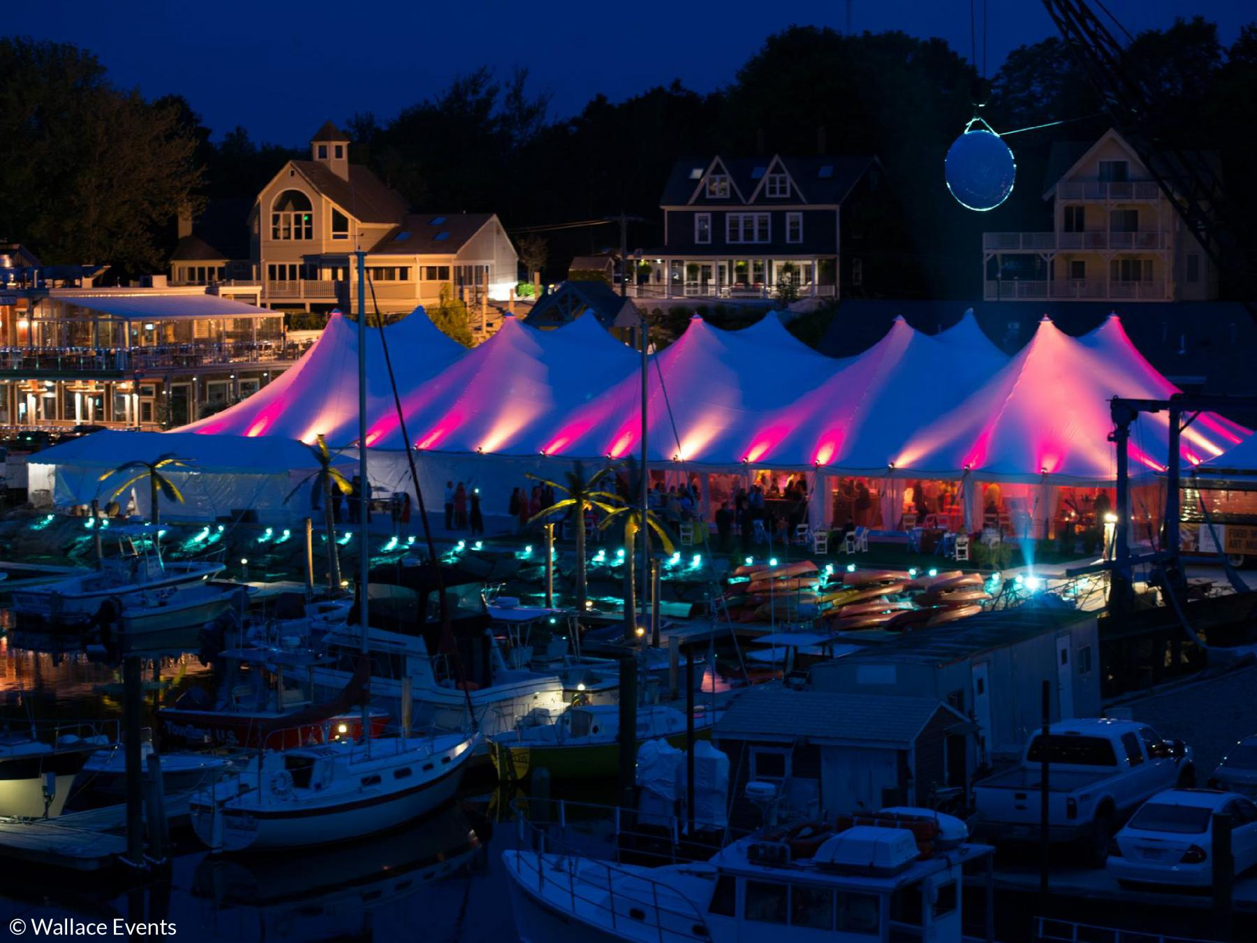Stillwater tent set up by a marina