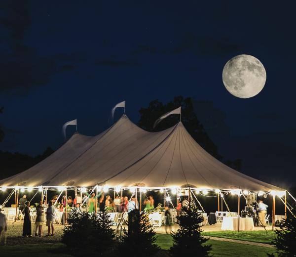 Stillwater tent under the moon